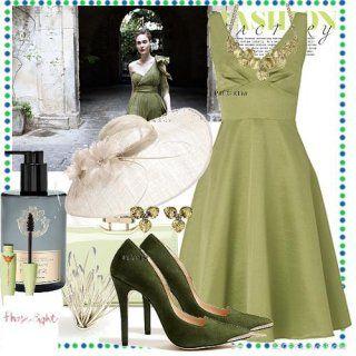 Вечірня сукня без рукавів світло-зеленого відтінку, приталеного крою, довжиною до колін.